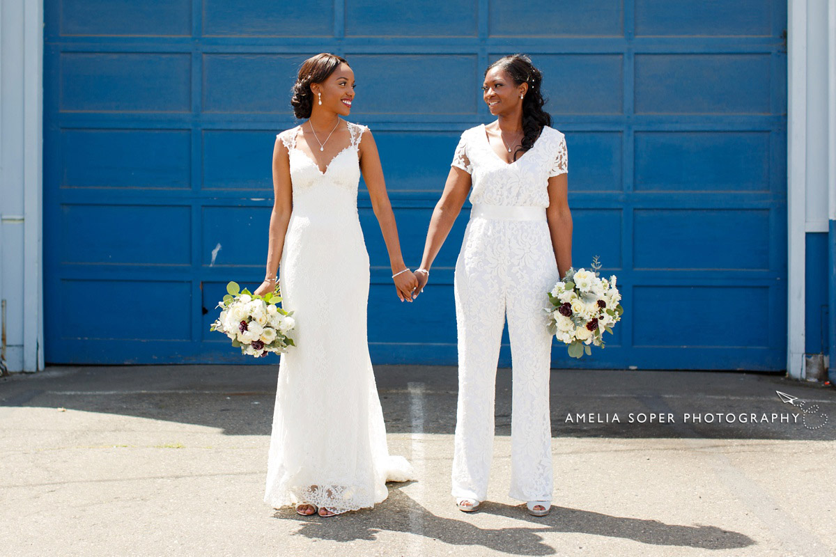 Lace wedding gown and jumpsuit. same sex seattle wedding at Within Sodo