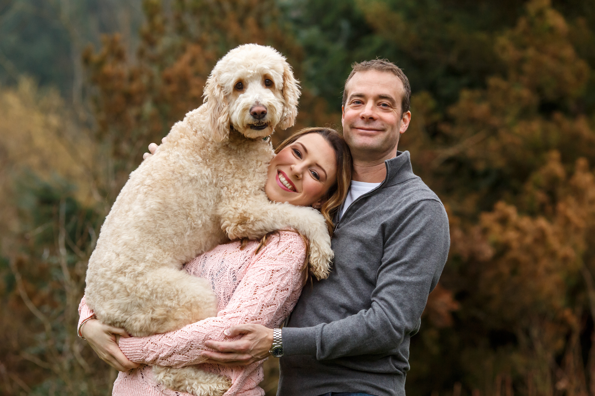 couple-with-goldendoodle